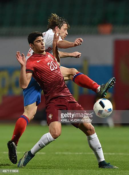 Portugal's Goncalo Guedes vies for the ball with Russia's defender Oleg Kuzmin during the friendly football match between Russia and Portugal in...
