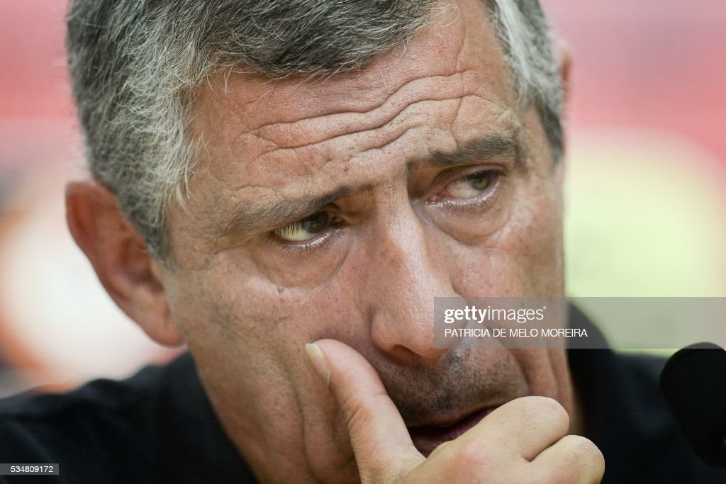 Portugal's head coach Fernando Santos gestures during a press conference on the eve of the friendly match Portugal vs Norway in preparation for the Euro 2016 at Portugal's team training center 'Cidade do Futebol' (Football City) in Oeiras, outskirts of Lisbon on May 28, 2016. / AFP / PATRICIA