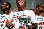 Portugal's head coach Fernando Santos holds the trophy accompanied by Portugal's forward Nani and Portugal's defender Vieirinha at Alameda square in...