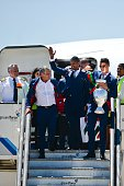 Portugal's head coach Fernando Santos Portugal's forward Nani and Portugal's forward Cristiano Ronaldo holding the trophy exit an aircraft on arrival...