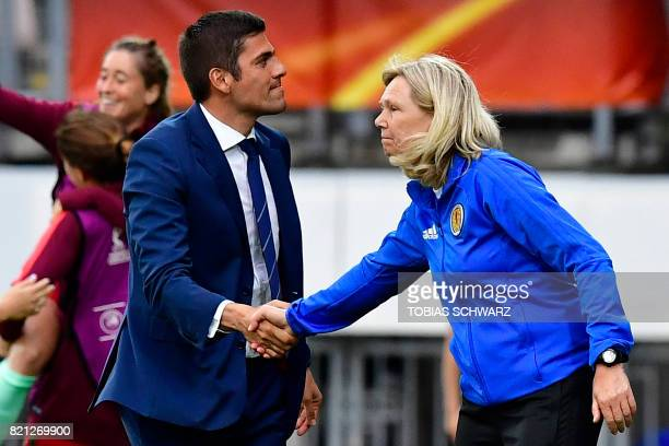 Portugal's head coach Francisco Neto and Scotland's head coach Anna Signeul shake hands at the end of the UEFA Women's Euro 2017 football tournament...
