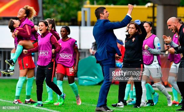 Portugal's head coach Francisco Neto celebrates with his team players at the end of the UEFA Women's Euro 2017 football tournament between Scotland...
