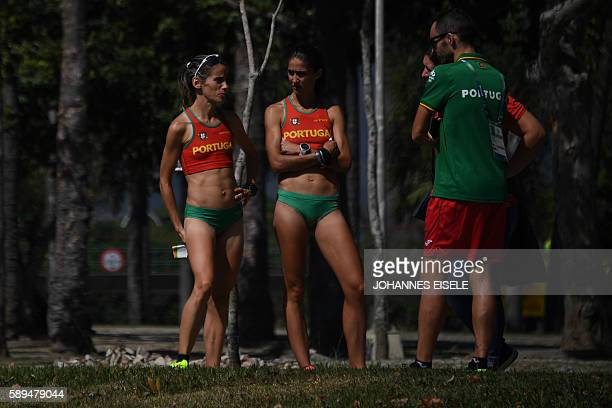 Portugal's Jessica Augusto and Portugal's Ana Dulce Felix are pictured during the Women's Marathon during the athletics event at the Rio 2016 Olympic...