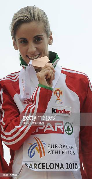 Portugal's Jessica Augusto bites her bronze medal on the podium during the medal ceremony for the women's 10000m at the 2010 European Athletics...