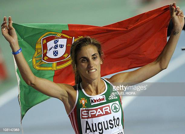 Portugal's Jessica Augusto celebrates after finishing third in the women's 10000m final at the 2010 European Athletics Championships at the Olympic...