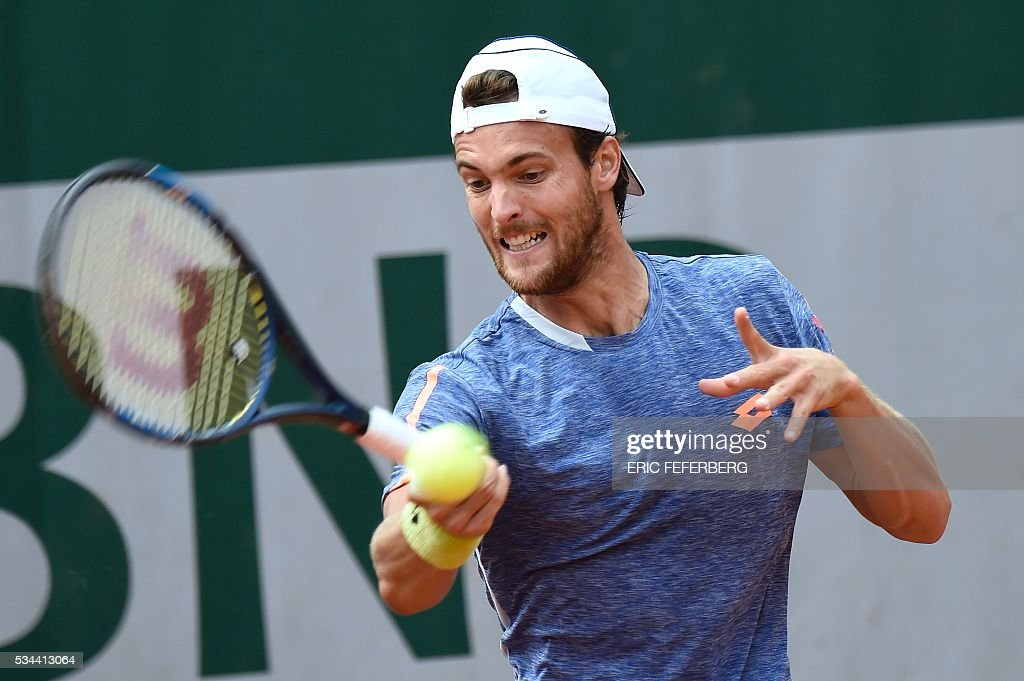 Portugal's Joao Sousa returns the ball to Latvia's Ernests Gulbis during their men's second round match at the Roland Garros 2016 French Tennis Open in Paris on May 26, 2016. / AFP / Eric FEFERBERG