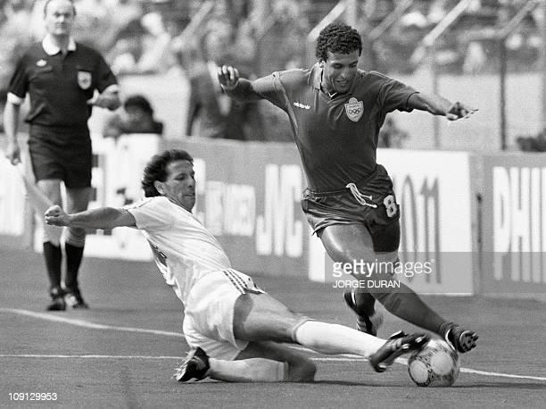 Portugal's Jose Pimental tackles Morocco's Bouderbala El Idrissi 11 June 1986 in Guadalajara during the the World Cup soccer match between Portugal...