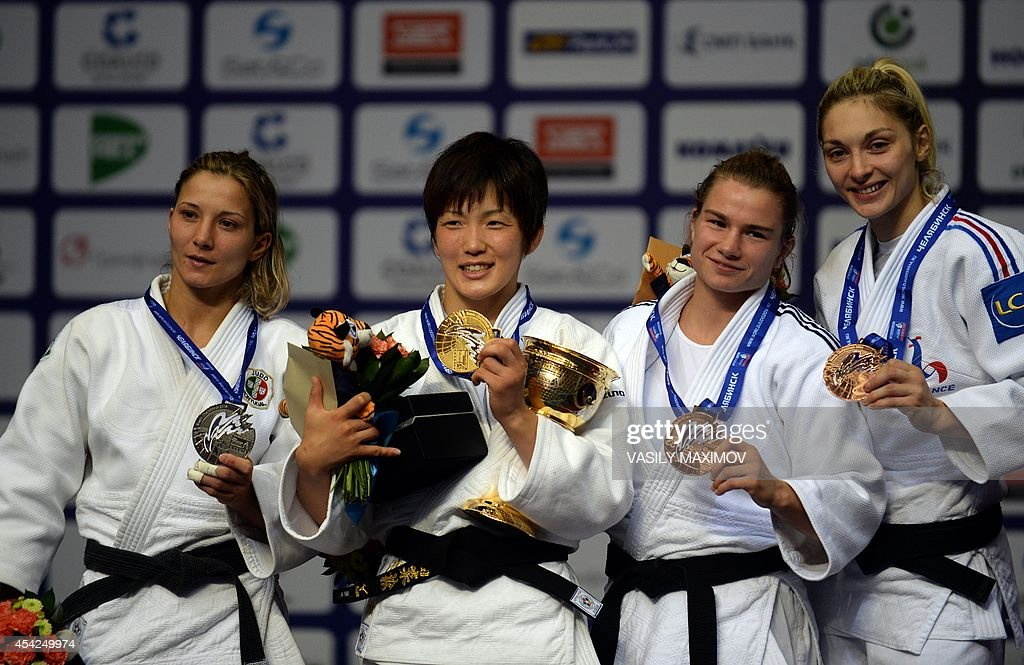 Portugal's judoka Telma Monteiro (silver medal), Japan's Nae Udaka (gold), Sanne Vehagen of the Netherlands and France's Automne Pavia (bronze) pose with their medals after the under 57 kg category competition at the IJF World Judo Championship in Chelyabinsk on August 27, 2014.