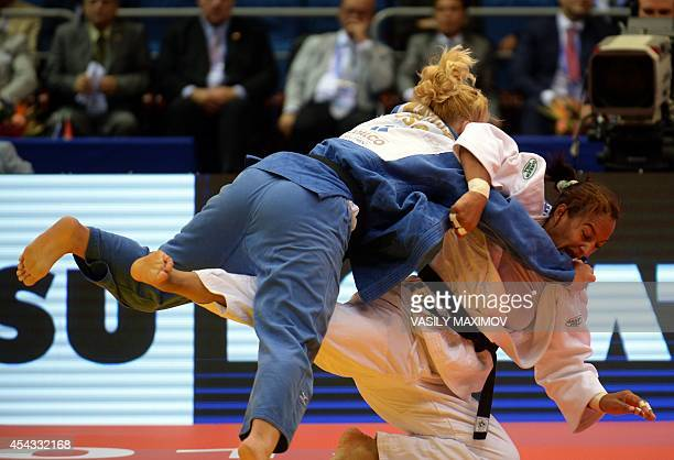 Portugal's judoka Yahima Ramirez competes with Kayla Harrison of the United States during the under 78 kg competition for bronze medal at the IJF...