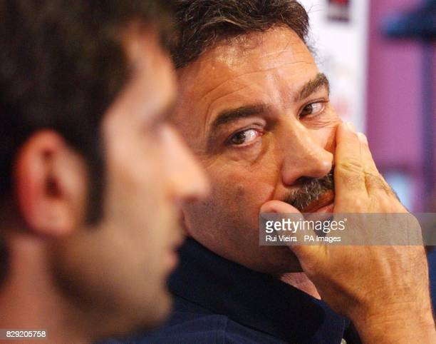 Portugal's manager Agostinho Oliveira looks to Luis Figo during a press conference at Villa Park Friday September 6 2002 England play Portugal in...