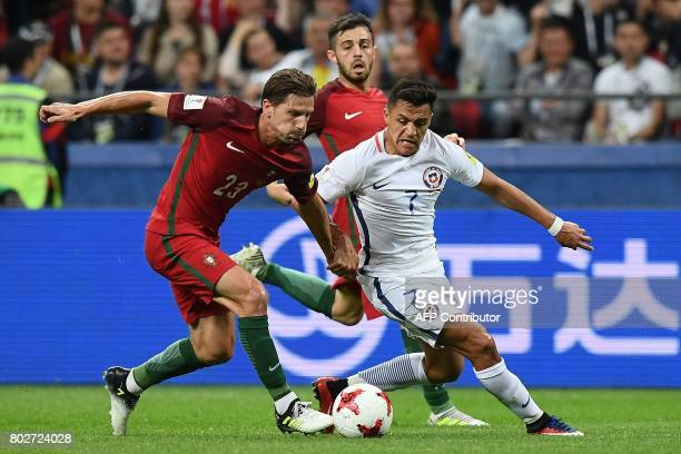 Portugal's midfielder Adrien Silva vies with Chile's forward Alexis Sanchez during the 2017 Confederations Cup semifinal football match between...