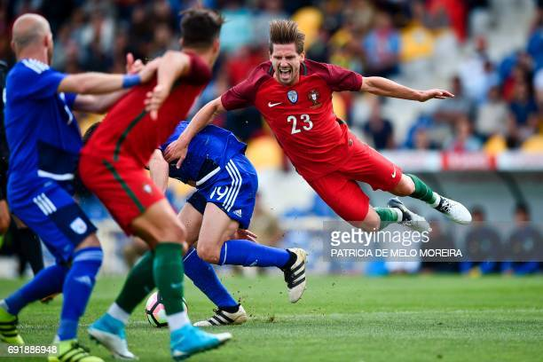 TOPSHOT Portugal's midfielder Adrien Silva vies with Cyprus' midfielder Kostakis Artymatas during the friendly international football match Portugal...