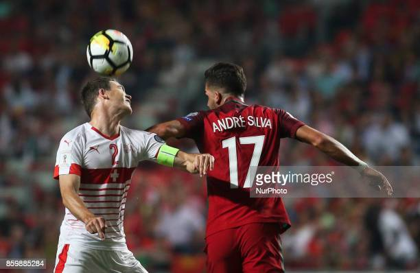 Portugal's midfielder Andre Silva vies with Switzerland's defender Stephan Lichtsteiner during the FIFA 2018 World Cup Qualifier match between...
