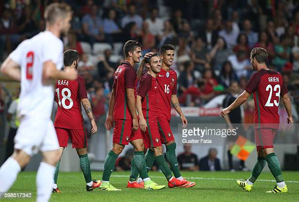 PortugalÕs midfielder Bernardo Silva celebrates with teammates after scoring a goal during the International Friendly match between Portugal and...