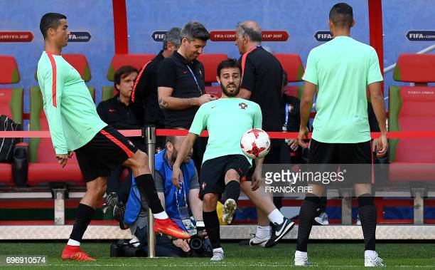 Portugal's midfielder Bernardo Silva controls the ball next to forward Cristiano Ronaldo during a training session at the Kazan Arena stadium in...