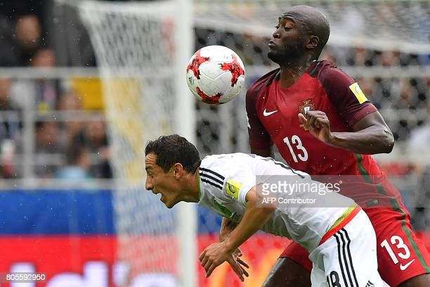 TOPSHOT Portugal's midfielder Danilo challenges Mexico's midfielder Andres Guardado during the 2017 FIFA Confederations Cup third place football...