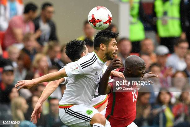 TOPSHOT Portugal's midfielder Danilo heads the ball with Mexico's forward Oribe Peralta during the 2017 FIFA Confederations Cup third place football...