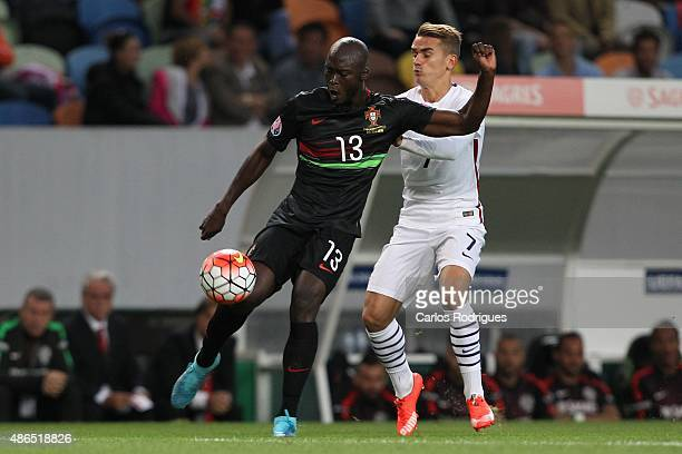 Portugal's midfielder Danilo Pereira vies with France's player Antoine Griezmann during the Friendly match between Portugal and France on September...