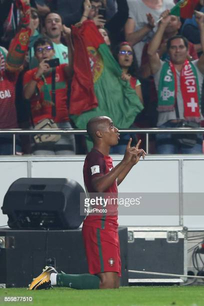 Portugal's midfielder Joao Mario celebrates after scoring a goal during the 2018 FIFA World Cup qualifying football match between Portugal and...