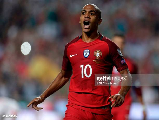 Portugals midfielder Joao Mario celebrates after Switzerland's defender Johan Djourou scored an own goal during the FIFA World Cup 2018 Group B...