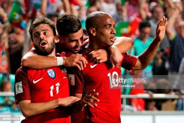 Portugals midfielder Joao Mario celebrates forward Andre Silva and midfielder Bernardo Silva after Switzerland's defender Johan Djourou scored an own...
