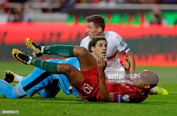 Portugals midfielder Joao Mario falls in front of Swiss goalkeeper Yann Sommer during the FIFA World Cup 2018 Group B qualifier football match...