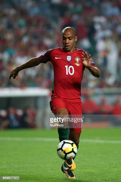 Portugal's midfielder Joao Mario in action during the 2018 FIFA World Cup qualifying football match between Portugal and Switzerland at the Luz...