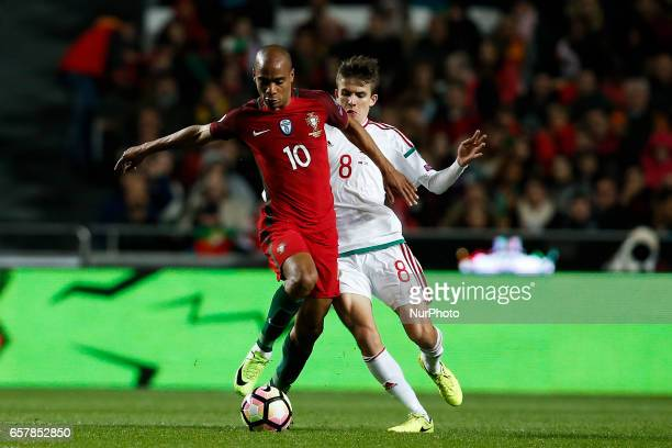 Portugal's midfielder Joao Mario vies for the ball with Hungary's midfielder Adam Nagy during the WC 2018 qualifier football match between Portugal...