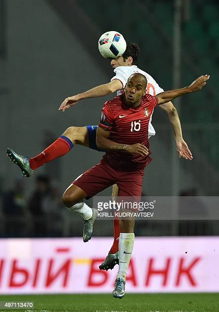 Portugal's midfielder Joao Mario vies for the ball with Russia's midfielder Alan Dzagoev during the friendly football match between Russia and...