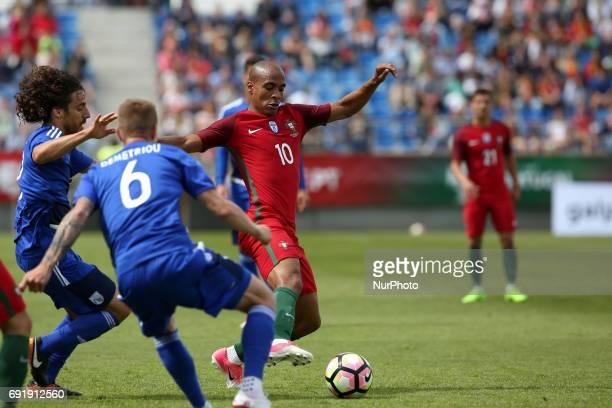 Portugal's midfielder Joao Mario vies with Cypruss defender Jason Demetriou and Cypruss midfielder Renato Margaca during the friendly football match...