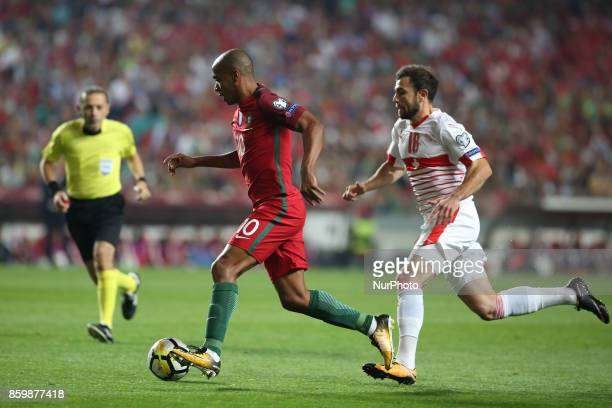 Portugal's midfielder Joao Mario vies with Switzerland's forward Admir Mehmedi during the 2018 FIFA World Cup qualifying football match between...