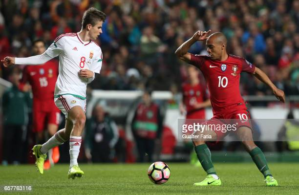 Portugal's midfielder Joao Mario with HungaryÕs midfielder Adam Nagy in action during the FIFA 2018 World Cup Qualifier match between Portugal and...