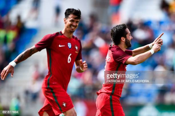Portugal's midfielder Joao Moutinho celebrates with his teammate Portugal's defender Jose Fonte after scoring during the friendly international...