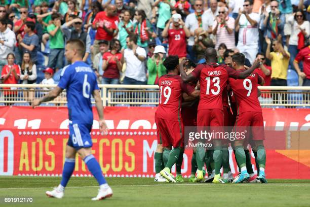 Portugal's midfielder Joao Moutinho celebrates with teammates after scoring during the friendly football match Portugal vs Cyprus at Antonio Coimbra...