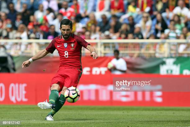 Portugal's midfielder Joao Moutinho shoots to score during the friendly football match Portugal vs Cyprus at Antonio Coimbra da Mota Stadium in...
