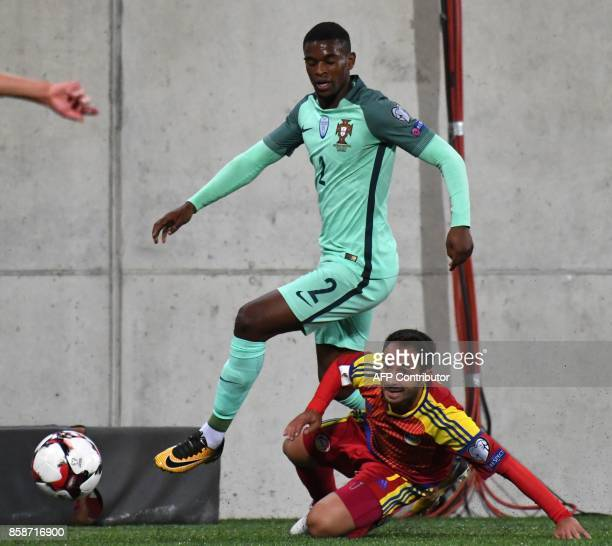 Portugal's midfielder Nelson Semedo vies with Andorra's forward Ludovic Clemente during the FIFA World Cup 2018 football qualifier between Andorra...