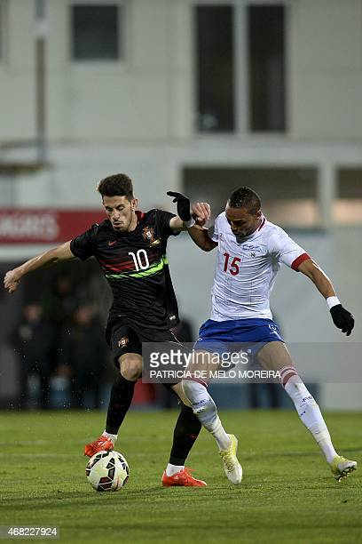 Portugal's midfielder Pizzi vies with Cape Verde's midfielder Nuno Rocha during the EURO 2016 friendly football match Portugal vs Cape Verde at the...