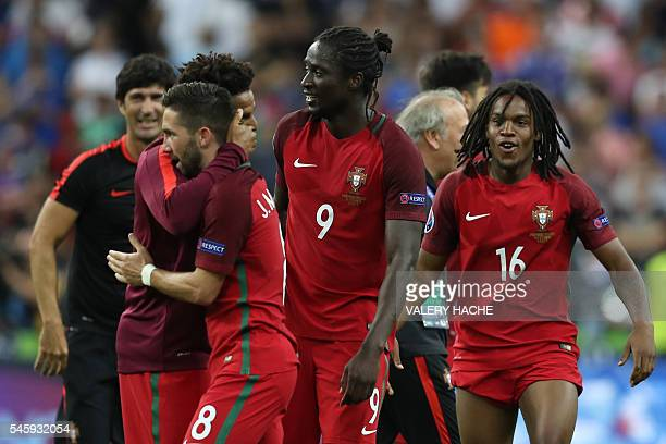 Portugal's midfielder Renato Sanches and Portugal's forward Eder celebrate after beating France during the Euro 2016 final football match at the...