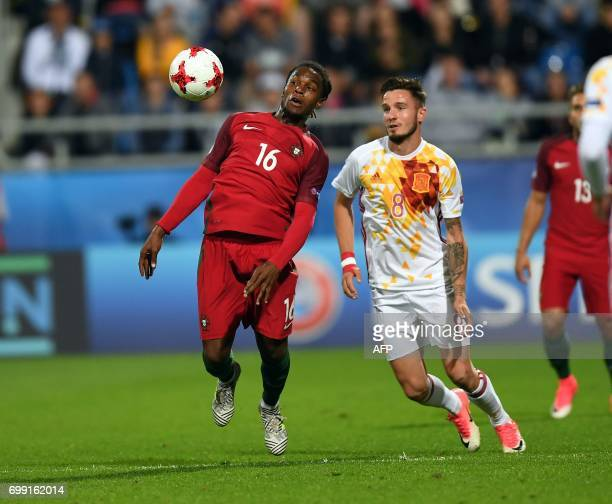 Portugal's midfielder Renato Sanches and Spain's midfielder Saul Niguez Esclapez in action during the UEFA U21 European Championship Group B football...