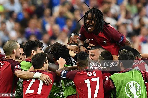 Portugal's midfielder Renato Sanches celebrates after Portugal's forward Eder scored the team's first goal during the Euro 2016 final football match...