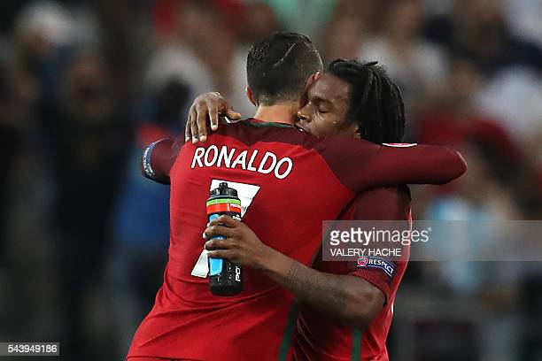 Portugal's midfielder Renato Sanches celebrates with Portugal's forward Cristiano Ronaldo after scoring during the Euro 2016 quarterfinal football...