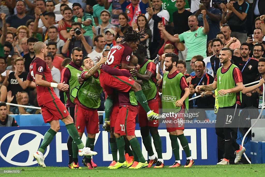 Portugal's midfielder Renato Sanches (C) celebrates with teammates after scoring his team's first goal during the Euro 2016 quarter-final football match between Poland and Portugal at the Stade Velodrome in Marseille on June 30, 2016. / AFP / ANNE