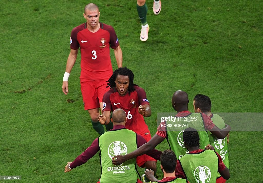 Portugal's midfielder Renato Sanches (C) celebrates with teammates after scoring during the Euro 2016 quarter-final football match between Poland and Portugal at the Stade Velodrome in Marseille on June 30, 2016. / AFP / BORIS