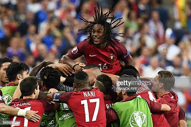 TOPSHOT Portugal's midfielder Renato Sanches celebrates with teammates after Portugal beat their hosts France 10 in the Euro 2016 final football...