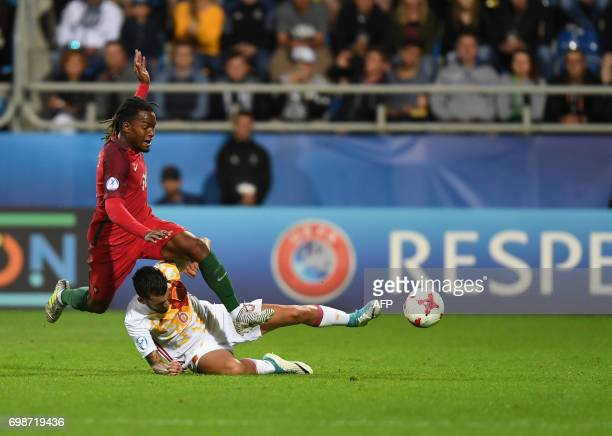 Portugal's midfielder Renato Sanches is tackled by Spain's midfielder Daniel Ceballos during the UEFA U21 European Championship Group B football...