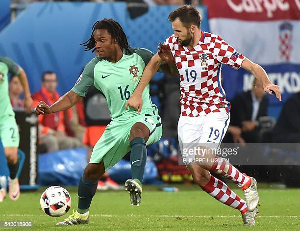 Portugal's midfielder Renato Sanches vies with Croatia's midfielder Milan Badelj during the Euro 2016 round of sixteen football match Croatia vs...