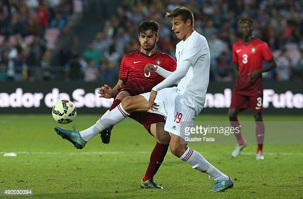 Portugal's midfielder Ruben Neves with Hungary's forward Norbert Balogh in action during the UEFA European Under 21 Championship Qualifier match...