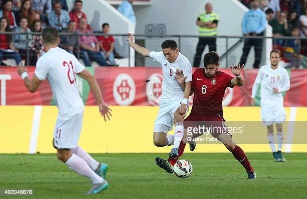 Portugal's midfielder Ruben Neves with Hungary's midfielder Mate Vida in action during the UEFA European Under 21 Championship Qualifier match...