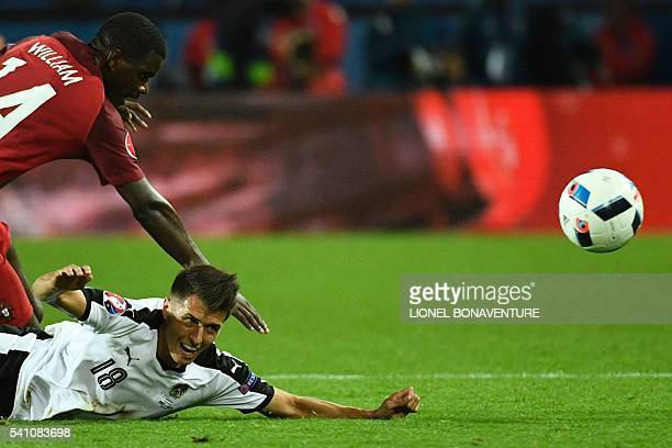 TOPSHOT Portugal's midfielder William Carvalho amd Austria's midfielder Alessandro Schoepf vie for the ball during the Euro 2016 group F football...
