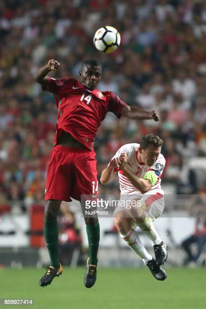 Portugal's midfielder William Carvalho fights for the ball with Switzerland's defender Stephan Lichtsteiner during the 2018 FIFA World Cup qualifying...